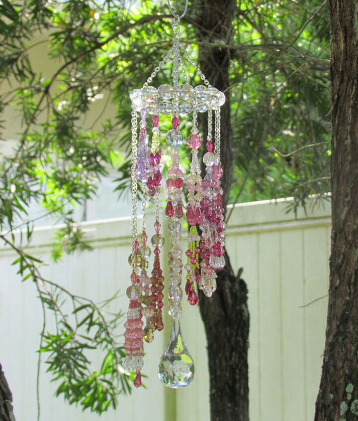 Made 14, crystal tassels with  Beadalon 49 count stainless steel wire. hung each tassel on steel chains, at varying lengths. Attached each to a circle made of 18 gauge steel wire with round crystals strung between each tassel
