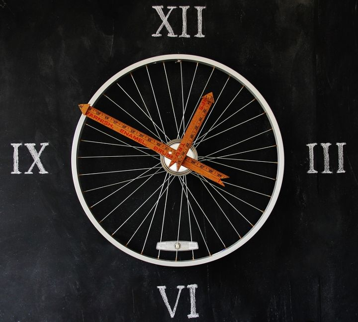 upcycled bicycle wheel clock, repurposing upcycling, A bicycle wheel clock with yardstick hands looks fabulous on a chalkboard wall