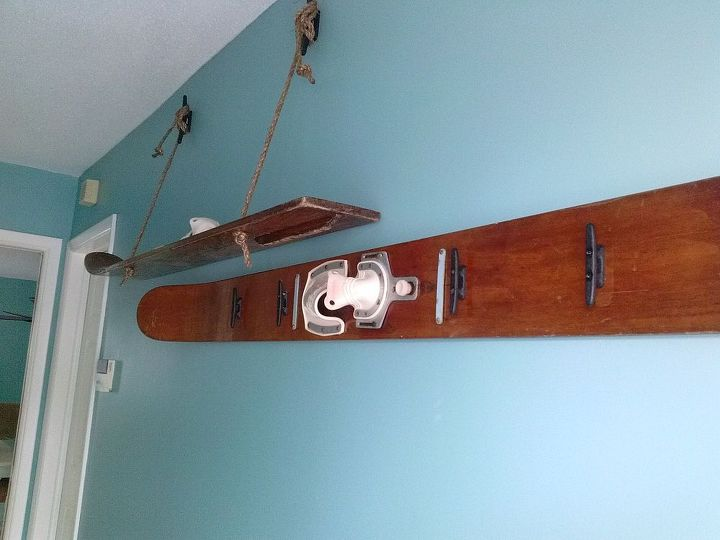 """Some nautical rope cleats for """"coat hangers"""" and larger rope cleats to hang the shelf from.  Add some rope and voila!"""
