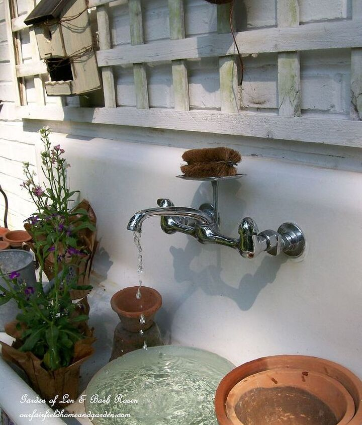This 1916 kitchen sink cost thirty dollars and another thirty went into clear plastic tubing and a recirculating pump. Viola! A one-of-a-kind potting station and fountain! See more about this at http://ourfairfieldhomeandgarden.com