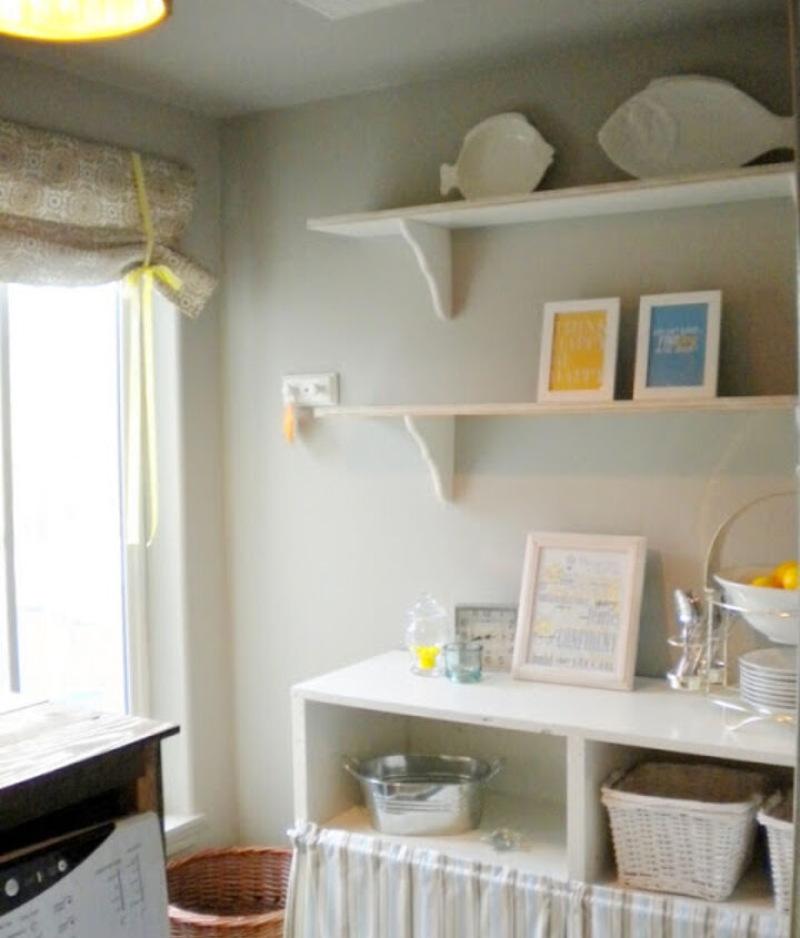 Unable to afford new built-in shelving or cabinetry we were forced to be creative and use what we had or could find for next to nothing.