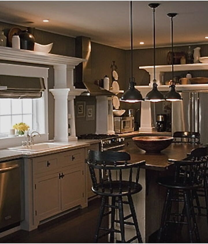 our kitchen features open shelving to display our collections of woodenware, crocks and dishes.