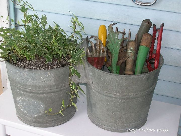 Old galvanized double bucket with garden tools