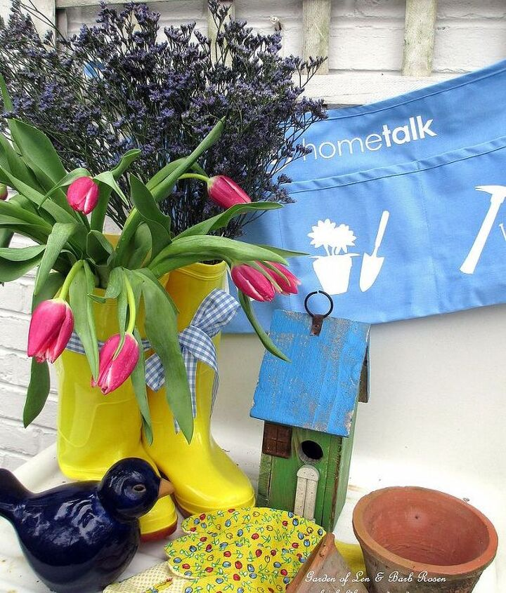 April rain boots filled with fresh tulips and statice on the potting sink. Hometalk work apron ready for action!