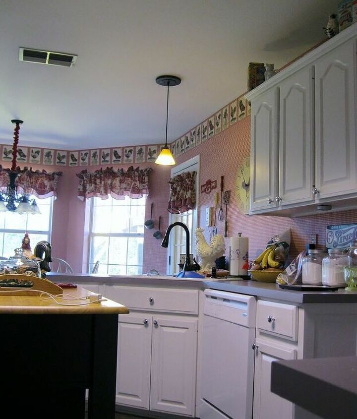 Before-The right side of the kitchen with sink, dishwasher, and upper cabs