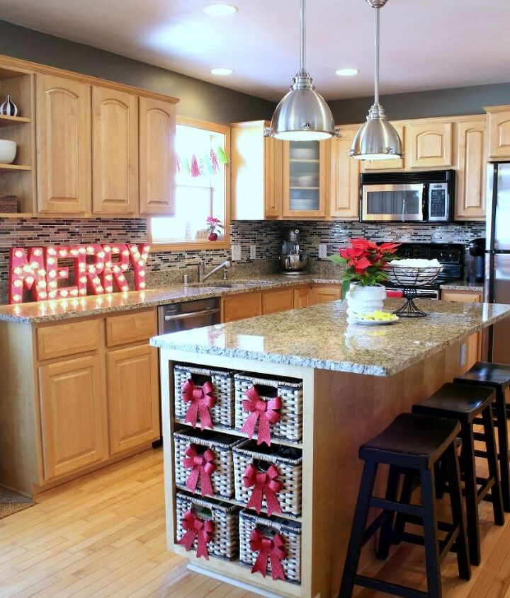 """Our kitchen, featuring DIY marquee letters to spell out """"MERRY"""" in lights, and DIY tissue paper tassels over our sink window.  They look so cute I want to keep them up all year long!"""
