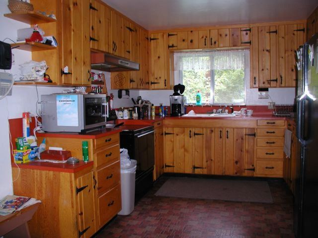 remodeling a dark dingy kitchen on a low budget, home decor, kitchen backsplash, kitchen design, Knotty pine doors are fine for a cabin but after a while the knots can get on your nerves