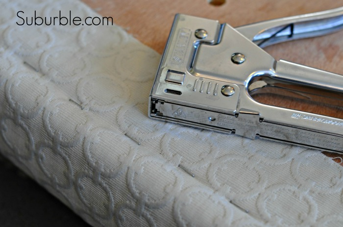 Reattach the new fabric using a staple gun (and use the pattern as a guide for a consistent look).