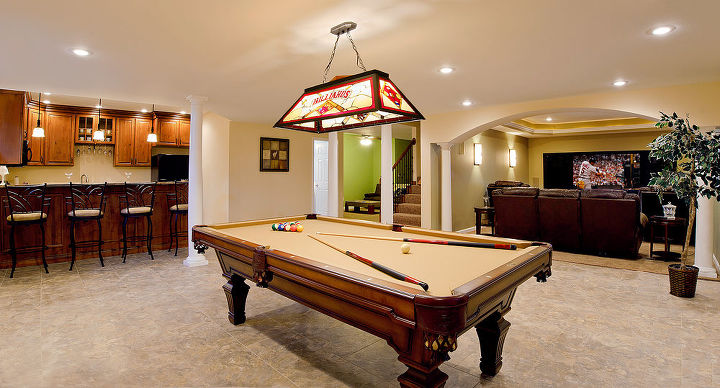 Luxury vinyl tile floors, split perma-cast columns, and recessed can lighting