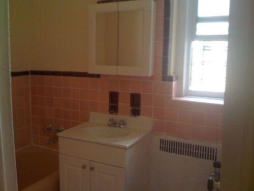 Pink tile and builder grade vanity! Maroon accent tile!
