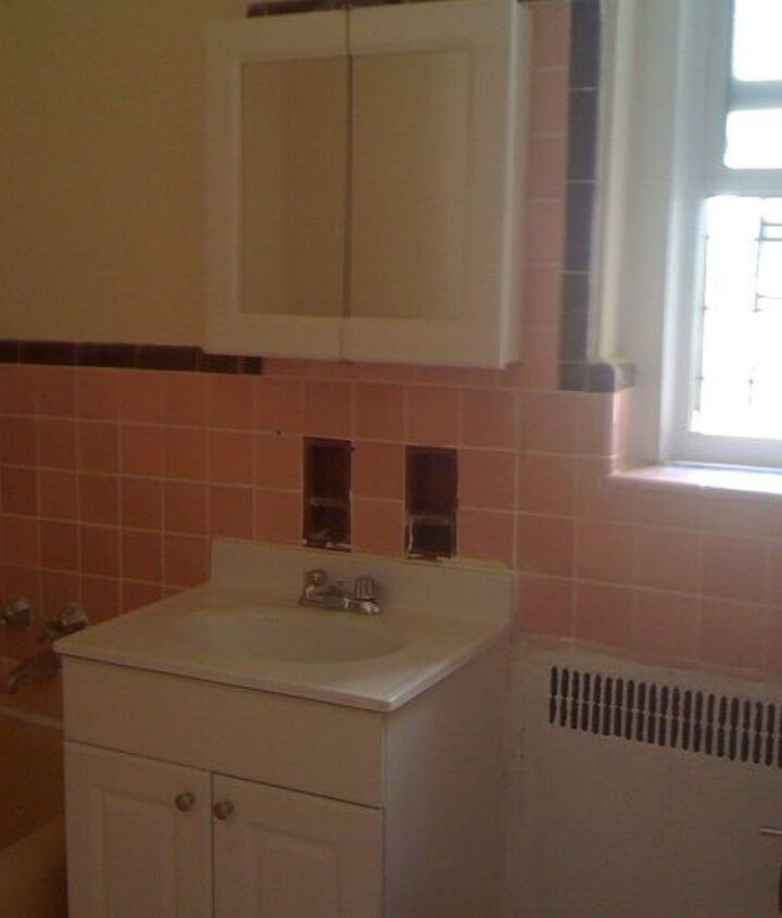 Pink tile and builder grade vanity! Maroon accent tile!