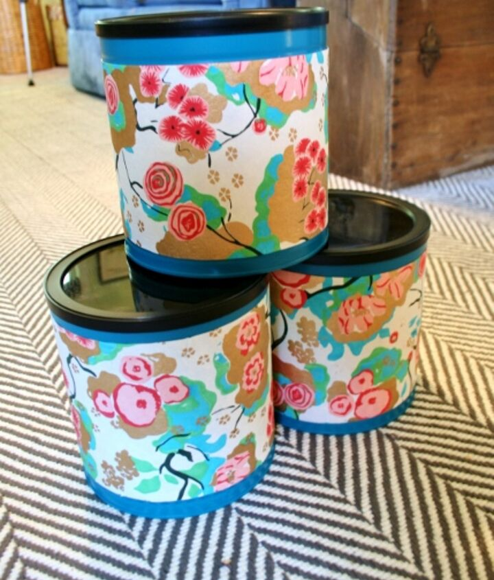 Tape the scrap paper around the coffee cans. This hides the ripples a little bit and gives it a higher end container look. Now, store all your items inside for pretty storage!