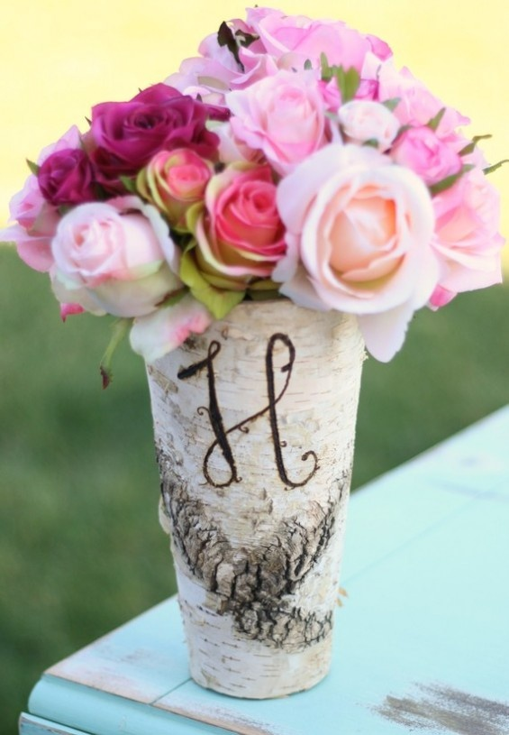 While we are talking about painting tin cans... you can personalise them by writing your initials on them.