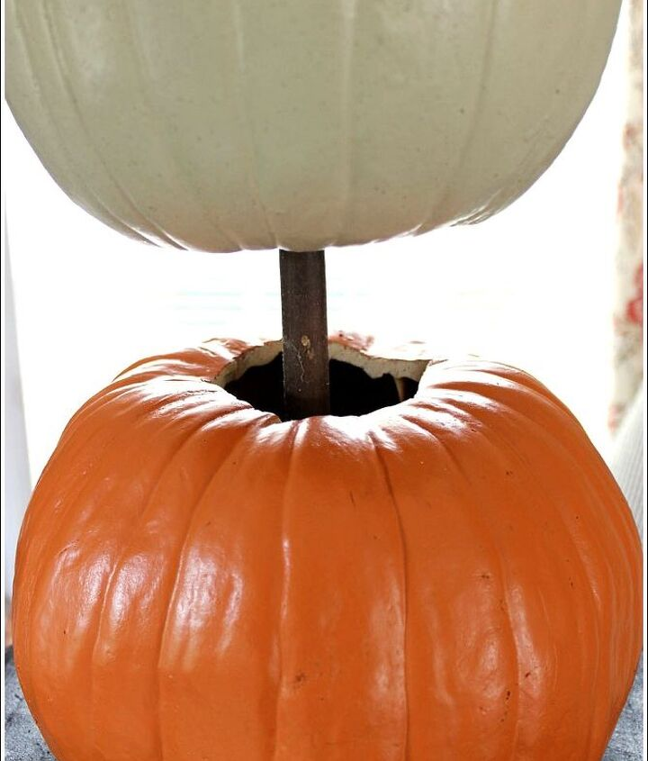pumpkin topiary fall decorating ideas, container gardening, crafts, gardening, seasonal holiday decor, Start by placing a Styrofoam block in your container Use a dowel to stack your carve able pumpkins You will need to remove two stems off of the two bottom pumpkins