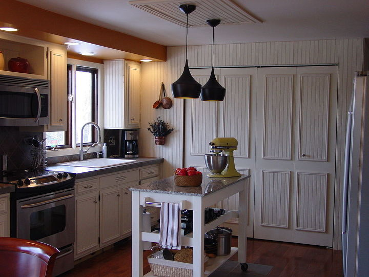 Kitchen redone, sink area, baking table and doors beyond hide the washer aand dryer.