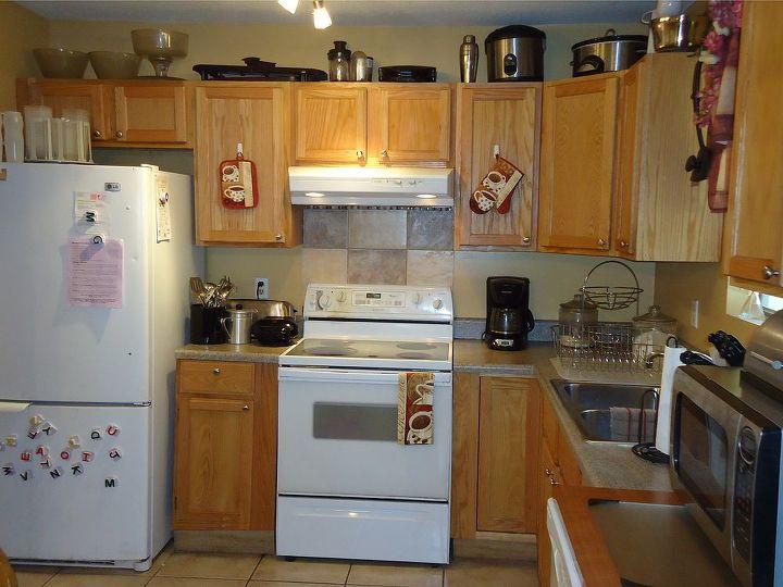 q our duplex remodel in amp out, doors, home decor, kitchen backsplash, kitchen design, tiling, Added knobs backsplash