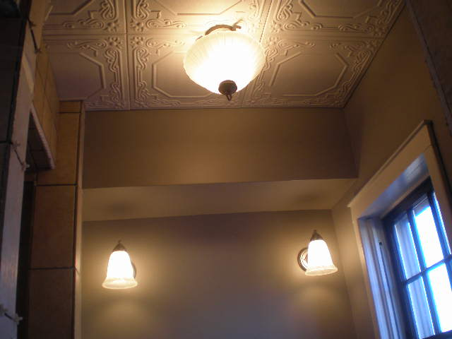ceiling tiles and fixtures in place.
