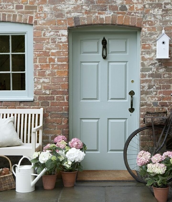 """Paint the door in a colour that says: """"warm and hospitable home just beyond this point""""."""