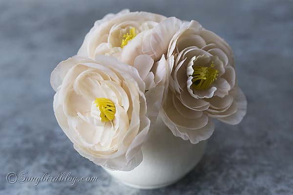 Tea dye faux flowers that are too brightly white to tone their color down.
