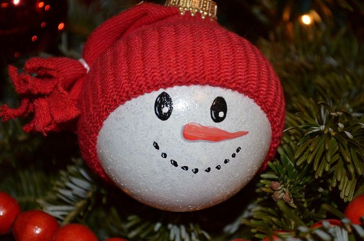 Snowman Ornament by GranArt. This little guy was made with a clear glass ornament, some enamel paint and a baby sock for the hat.