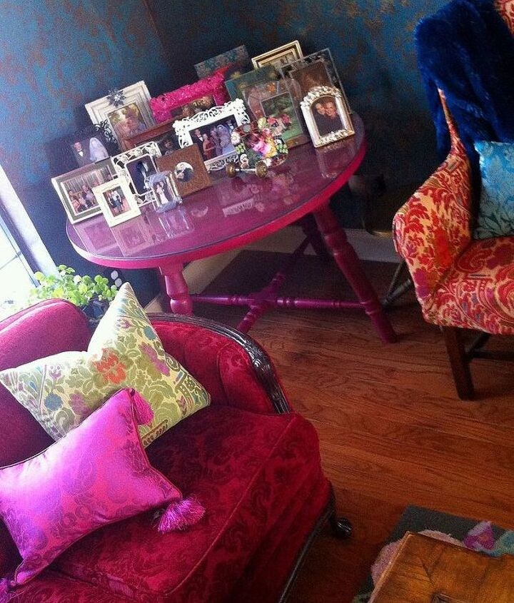 I love a table full of pictures.  This antique table painted hot-pink is perfect for the corner.