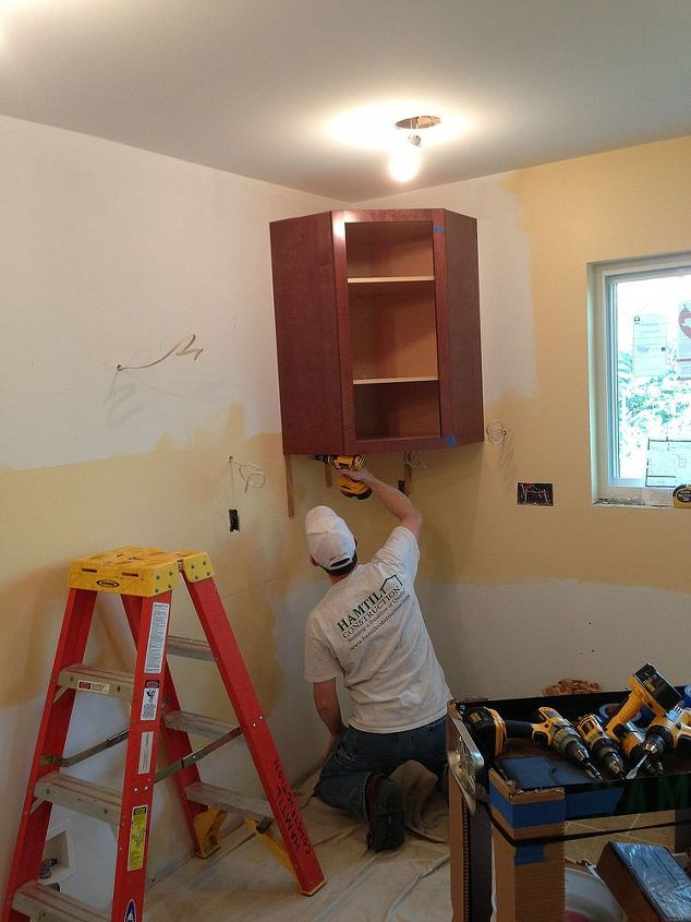 The first cabinet going up!