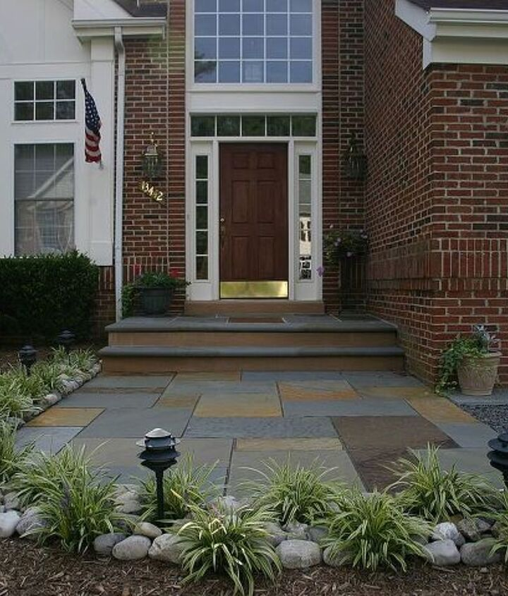 "We opened up the access using full color patterned flagstone 1 1/2"" thick. The leading edge of the step and stoop are bordered with 12""x8'x2"" thick flagstone with full bull nose and thermal treated."