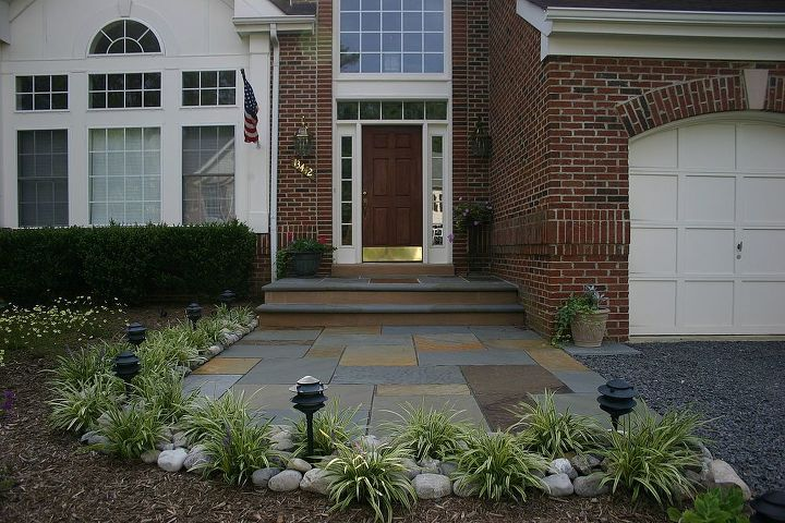"""We opened up the access using full color patterned flagstone 1 1/2"""" thick. The leading edge of the step and stoop are bordered with 12""""x8'x2"""" thick flagstone with full bull nose and thermal treated."""