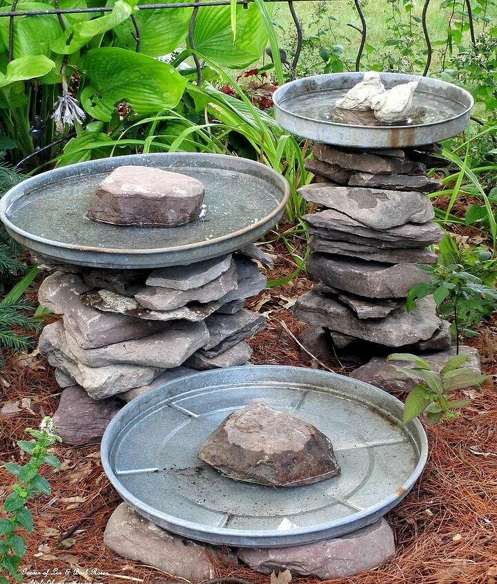 """Stone leftover from another project and three galvanized trash can lids become a bird bath grouping! Another of my """"use what you have"""" ventures! More pictures and directions at http://ourfairfieldhomeandgarden.com"""
