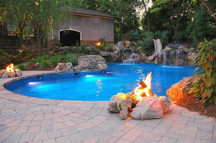 3 gas firepits keep the patios warm on a cool evening. These are photos are all of the same pool project, my personal favorite. www.deckandpatio.com