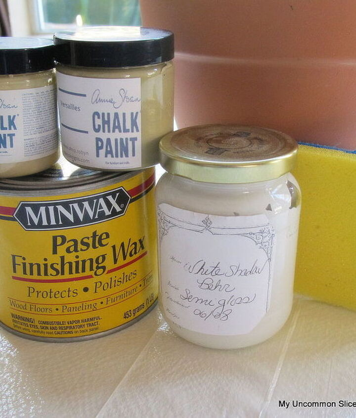 Grab whatever paint you have on hand, think creamy antique colors, a sponge and wax.  The wax will protect it from moisture and make the pots more durable.