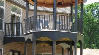 q decks come in all shapes and sizes like this curved deck built with ariddek aluminum, decks, home decor, outdoor living, patio