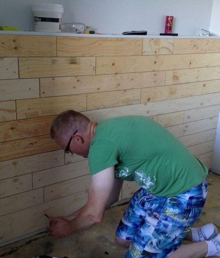 Bryan working on the wall that is behind her bed… will be like a headboard. We did all different lengths on this wall.
