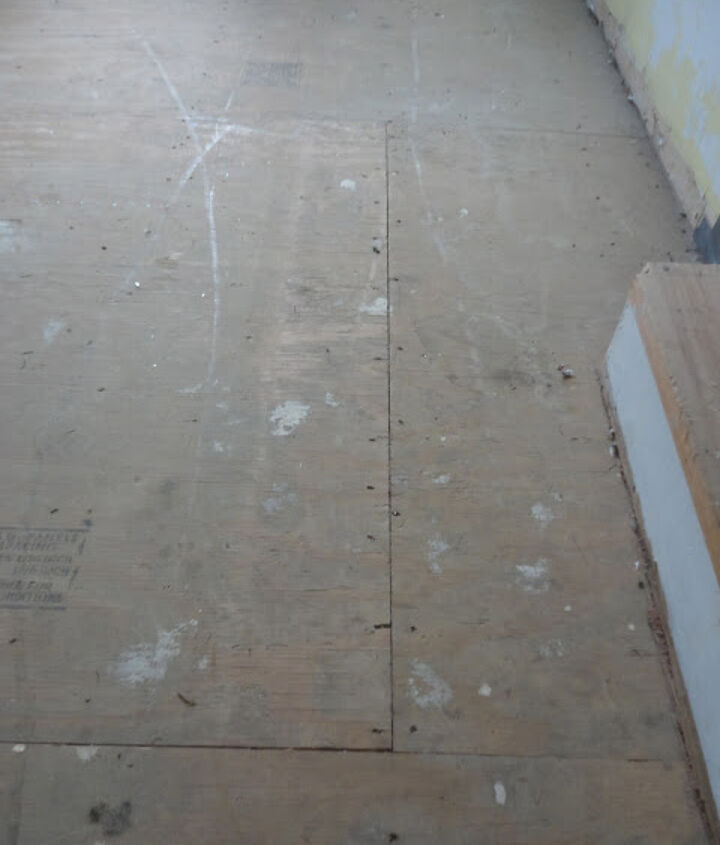 Here is the before - the ugly underlayment full of staples and paint.  I removed the staples, used wood filler to fill gaps and then painted them.