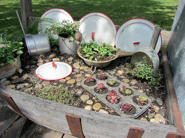 The Kitchen Fairy Garden was my first Hometalk post to be featured.  See how I used a half barrel and vintage kitchen utensils to create a fairy garden...http://organizedclutterqueen.blogspot.com/2012/05/kitchen-fairy-garden.html