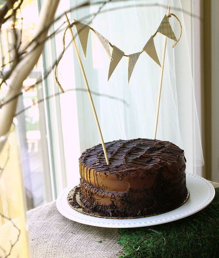 Purchased a store-made cake and decorated it with some craft paper and twine.  http://justagirlblog.com/woodland-party-part-1/