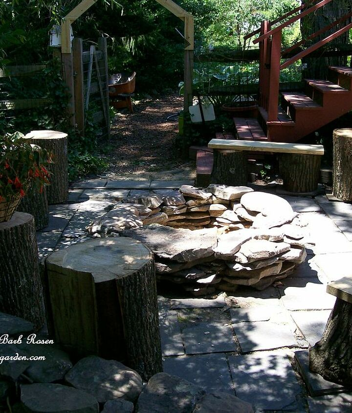 Build your own stacked stone fire pit with rustic benches and tables made from logs. This project was completed over three days and transformed a weedy slate patio into a family gathering place! See my blog at http://ourfairfieldhomean
