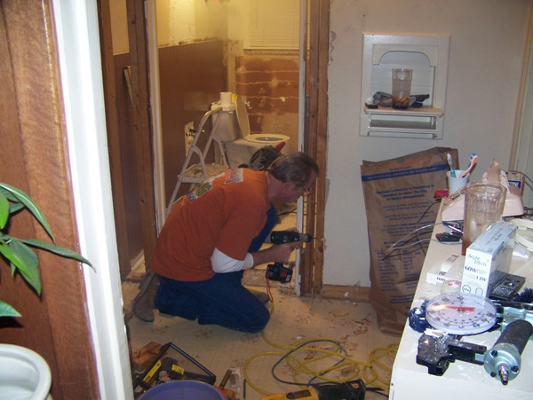 removing door frame and ming it 4 inches so the sink and cabinet would fit and be able to close the door.... Had a half an inch clearance afterwards, thats all I needed