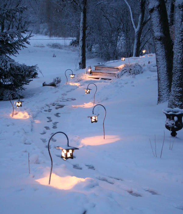 Pathway lights leading to the pond invite visitors to explore the landscape and water garden.