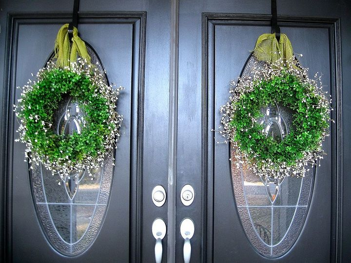 Faux boxwood wreaths with white pip berries and burlap ribbon.