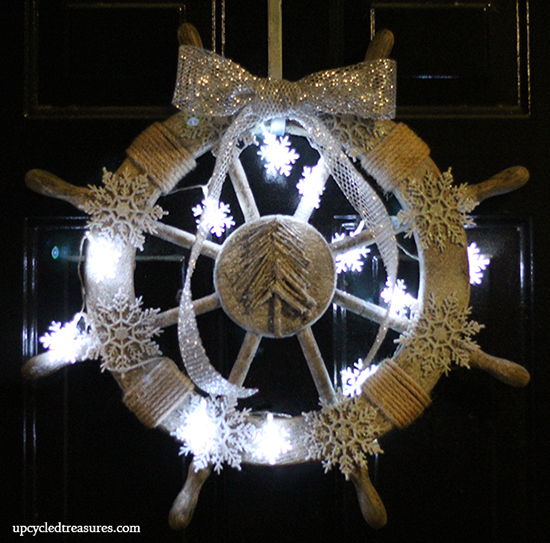 Here is my nautical wreath all lit up at night. I would have preferred warm lights over the cool ones, they are a tad bright for me. I still love it though :)
