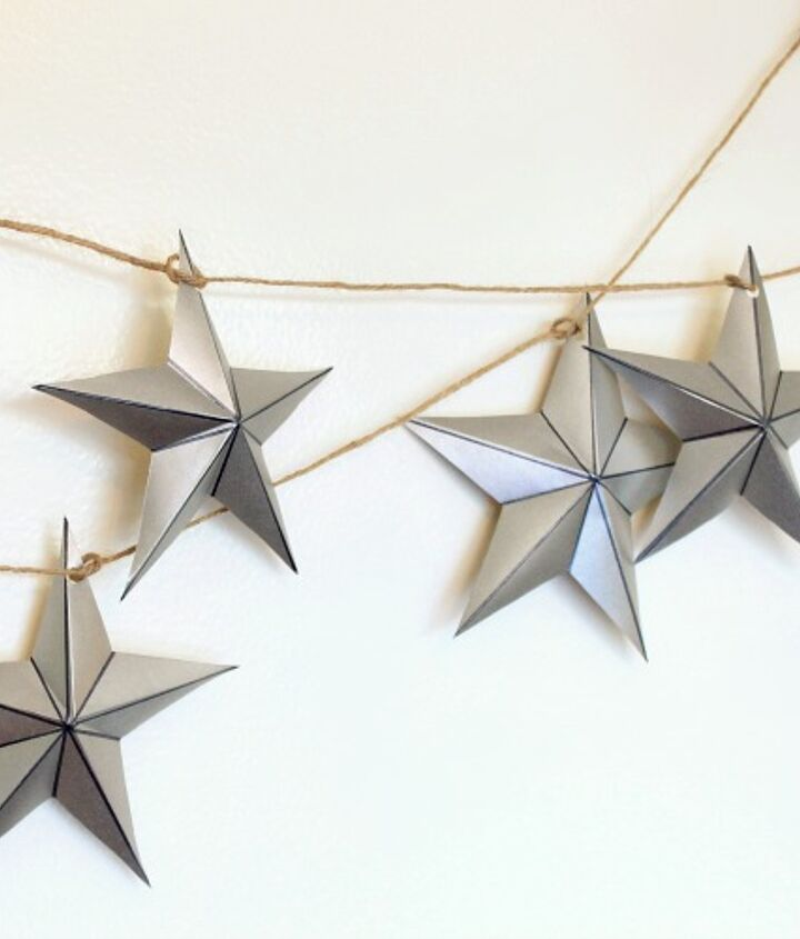 Creative use of wrapping paper- shiny stars to drape your windows for the holidays.  See more here: http://www.myclevernest.com/2012/12/2-embarassingly-easy-christmas-garlands.html#