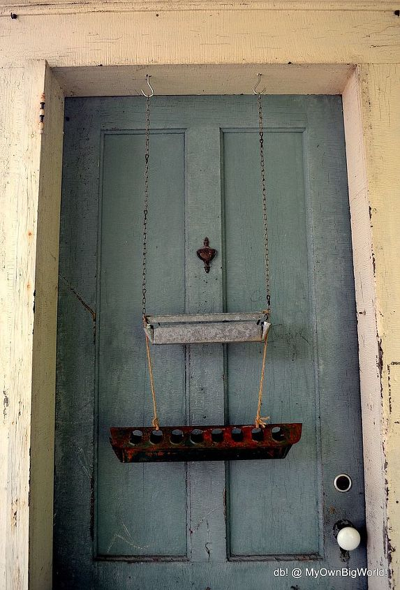 "Hangs on the old chippy painted door with the cute door knocker that says, ""Shhhh!""  ;o)"