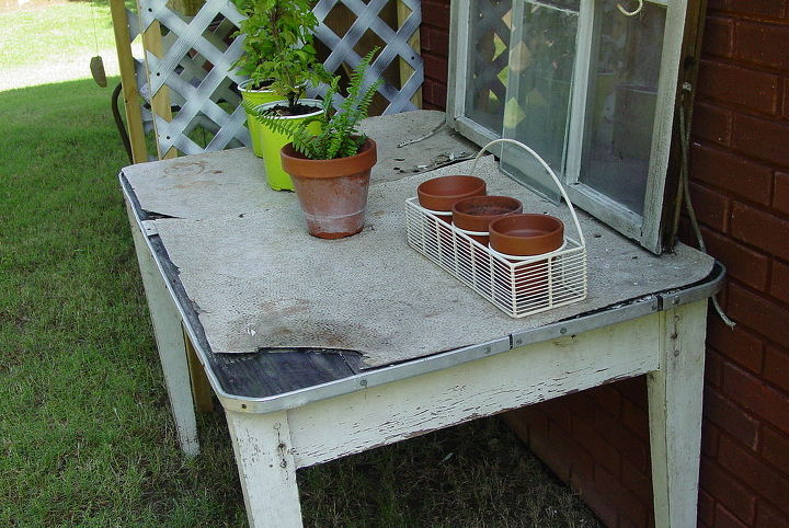 """I have the best brother in law! He was demolishing an old house and asked me if I wanted to go """"picking"""" before he started. He loaded up my picks and delivered them to my garage...this old table, a screen door, two wooden doors & more."""
