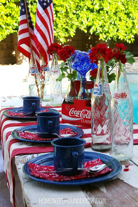 It's not always about flowers - check out those blue blown glass watering bulbs used in the centerpiece! http://homewardfounddecor.blogspot.com/2013/06/its-all-bottled-up.html
