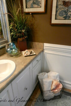 seashells and a wire basket, bathroom ideas, spas, A brown and blue bathroom is the perfect setting for fluffy white towels