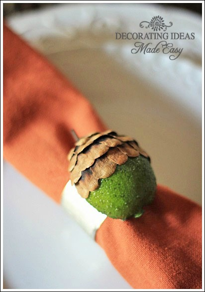 For this craft project you will need hot glue, pine cones, plastic limes, and a napkin ring.