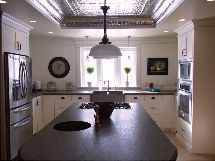 """Some of the details include copper sinks and taps, granite countertops with a 'leather' finish and natural tin ceiling.  Also, no upper cabinets, backsplash is 'v' groove paneling and countertops are 30"""" deep on this wall."""