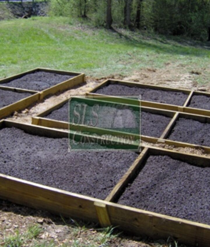 The final shot with mulch added – as reminder the object of a raised garden is not to hold water but rather to hold the soil which holds the water & help keep weeds out. If your garden dries out to quickly, consider adding mulch on top
