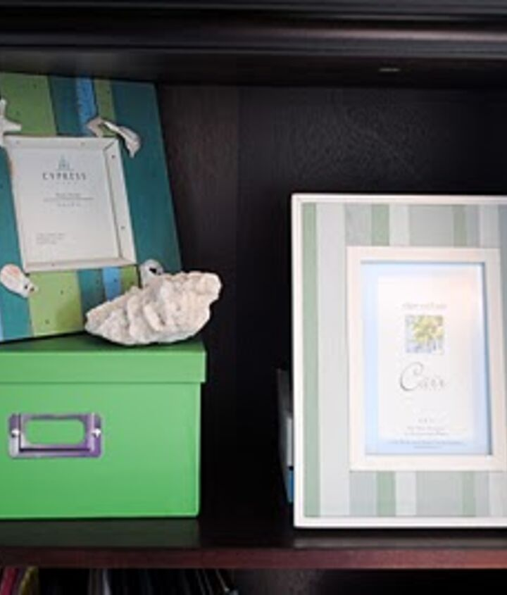 The bookcase holds special objects that reflect our love of the beach, and our love of our baby.  {awwww...}